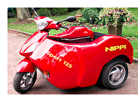 nippi gas powered un scooter accessible en fauteuil. Black Bedroom Furniture Sets. Home Design Ideas